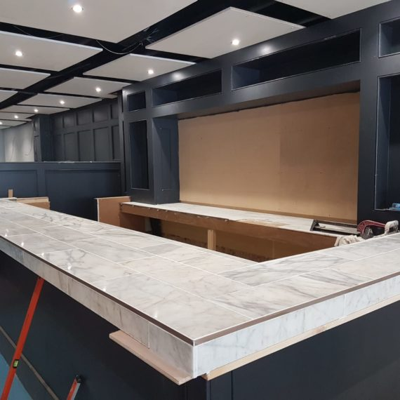 Bespoke restaurant bar, with a marble tiled worktop