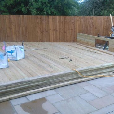 Custom wooden decking for a back garden in Littleport